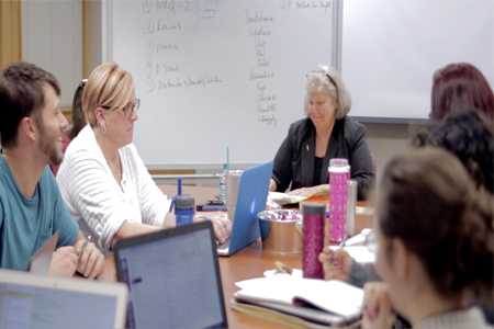 Professor Kathleen Yancey (emeritus) in a classroom with graduate students studying rhetoric and composition.